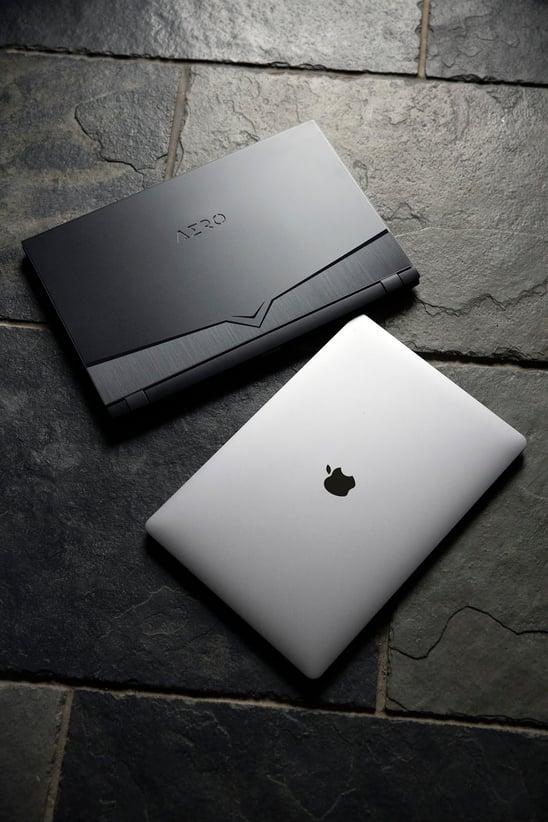 Aero and Macbook in same shot on tiled floor.jpg