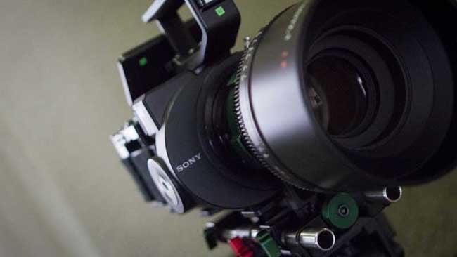 An FS700 in its natural habitat, hiding behind a massive cinema lens.jpg