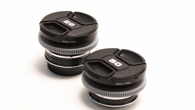 At short focal lengths, engineering  concerns can start to increase sizes again. The 28mm Nikon Series E is  larger than the 50mm