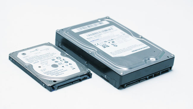 Both of these are hard disks. Flash  SSDs are often the same size and shape as the smaller drive. All of them  use the same data and power connectors_ the system doesn't care
