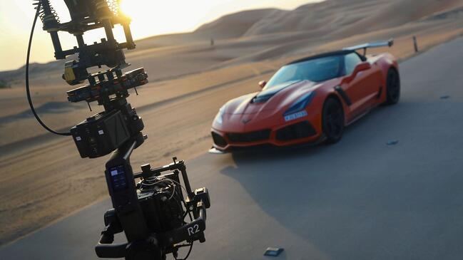C700FF on crane with Corvette in background against sunset_Small.jpg