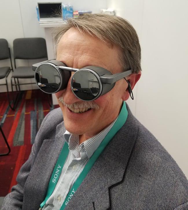 Chinnock wearing Panasonic VR glasses.jpg