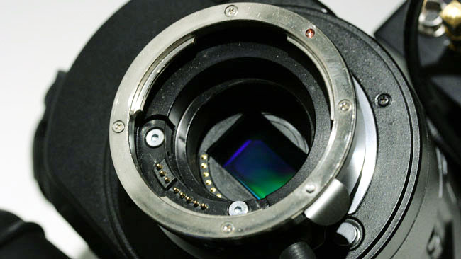 Compare the micro four-thirds mount, inside, with the larger EF mount on this MTF Effect lens controller and adaptor.JPG