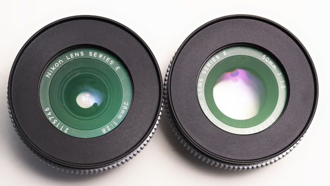 Maximum entrance pupil. The 28mm  lens (left) has a maximum aperture of f 2.8, while the 50mm achieves 1.8.  Notice the larger hole in the 50