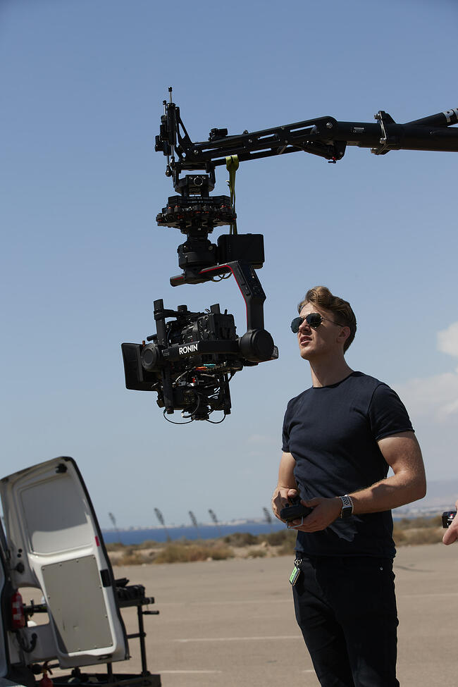 Operator with C500 II on Ronin and Russian arm in focus.jpg