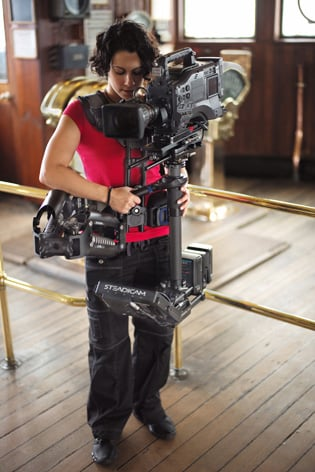 Steadicam_instructor_Kat__Kallergis_with_the_new_Steadicam_M-1_and_the_Fawcett_Exovest-_a_Gold_Workshop_on_board_the_Queen_Mary_Long_Beach_California.jpg