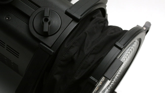 The lens extension is surrounded by   a black fabric cowl.JPG