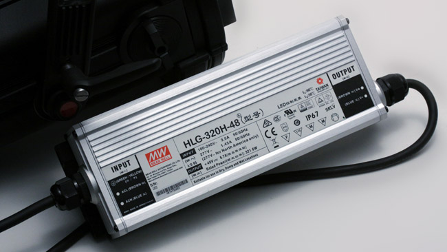 The power supply is separate and   silent. A clamp is supplied to hold it onto a stand.JPG