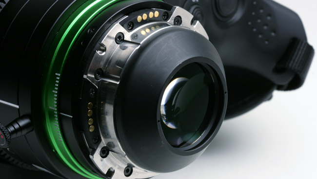 The primary purpose of this PL  mount is to hold the attached Fujinon XK6x20 lens precisely 52mm from the  imaging sensor