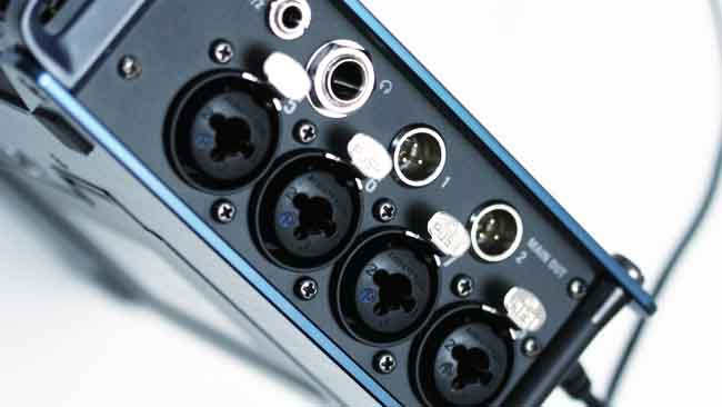 The right face holds inputs 5-8,  the main and sub outputs, and the headphone jack. The jacks are bolted  through the side of the metal case.