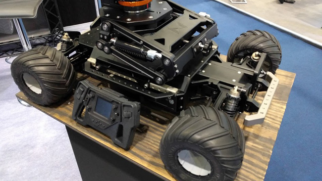 This might look like a giant radio-controlled car, and it sort of is, but it also provides some multi-axis isolation for its gimbal (not shown, above the chassis).jpg