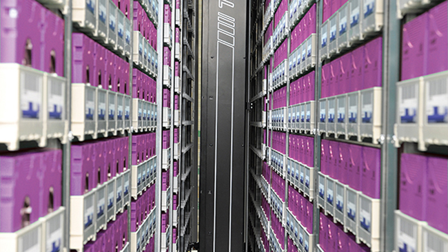 Unsurprisingly_the_working_parts_look_like_rack_after_rack_of_data_tapes_with_a_robotic_retreival_system_whirring_aorund_inbetween_them