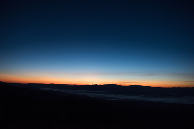 The blue hour, before sunrise or sunset.