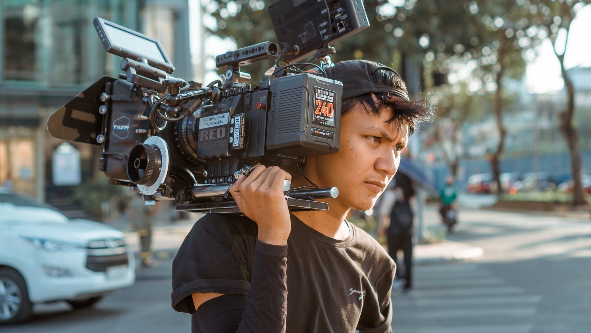 Filmmaker with camera.