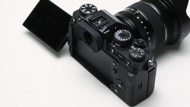 Fujifilm X-T4 flip-out LCD screen and top controls.