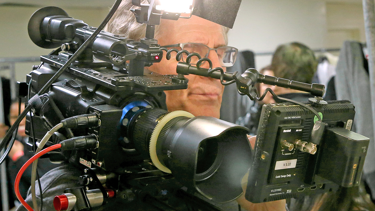 This is not user-friendly, nor ergonomic. Camera design needs a rethink according to Roland Denning.